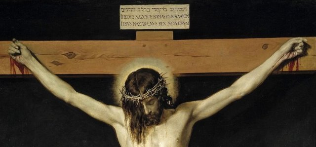 """Detail of Velazquez's Crucifixion of Christ, with inscription over the cross indicating inherently political nature of Jesus' punishment : """"Jesus of Nazareth, King of the Jews"""" in Hebrew, Greek, and Latin"""